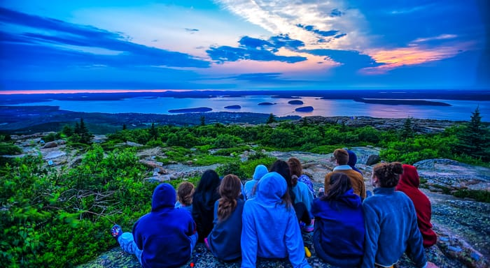 Campers watching sunrise on Cadillac Mountain